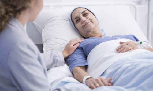 Palliative Care by Melin Care - woman in bed with Palliative care assistant